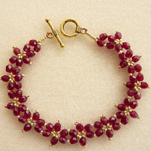 All About Beads - Garnet coloured beaded bracelet