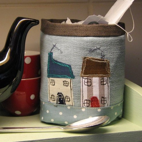 Beautiful little fabric pot with applique houses