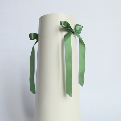 White Ceramic Vase with Green Ribbon