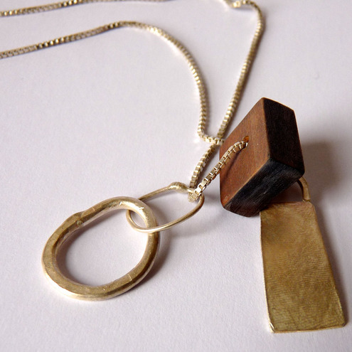 Wooden and silver pendant