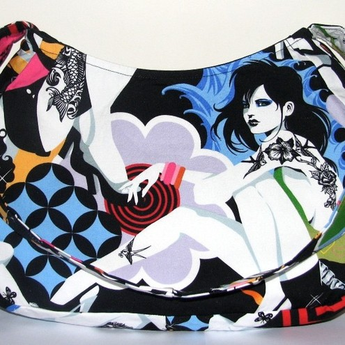 "Henry's ""Inked"" fabric featuring Rock Chick tattooed girls with hearts,"