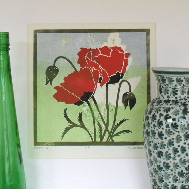 Bright red poppies against a delicate background of pale blue and green
