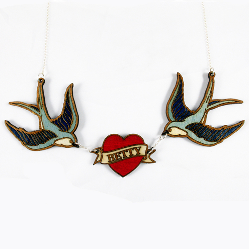 in solid american walnut featuring two beautiful tattoo style swallows,