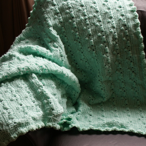 Beautiful green blanket.