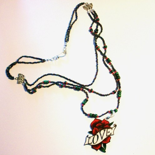 Another Love Rose tattoo necklace. This time, the handmade pendant is clear