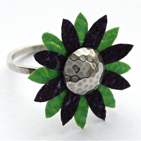 The petals of this ring are made by fusing together several layers of plastic bags!