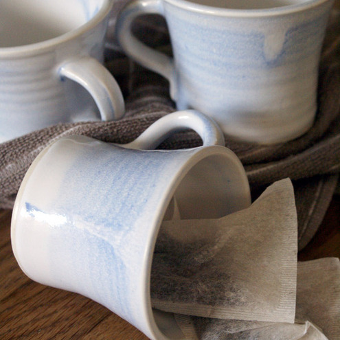 Set of four porcelain cups - powder blue and white pottery mugs for tea or coffee