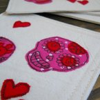 embroidered sugar skulls fabric coasters, by fiona t