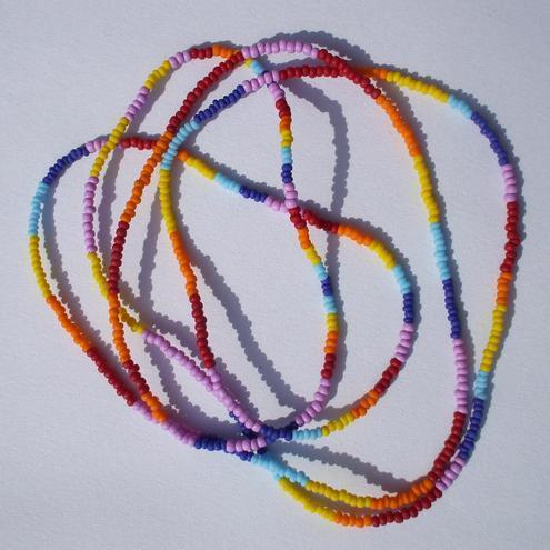 Colorful seedbead necklaces love beads that were made by a man or woman