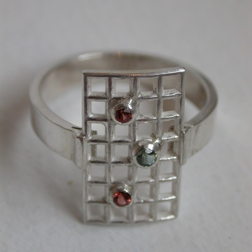 Satin and Sequins Sterling Silver Green Sapphire and Garnet Ring by Pebblestone