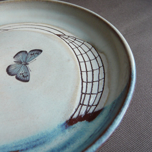 Hand thrown ceramic plate with butterfly