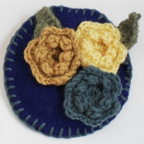 Crocheted Flower Brooch by Josie Mary