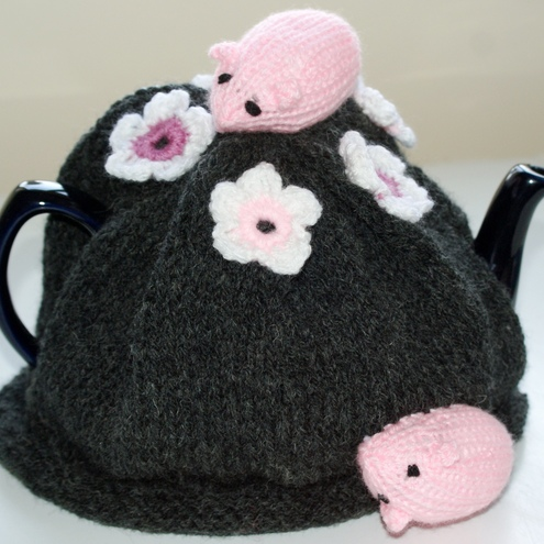 hand knitted mice and daisy tea cosy