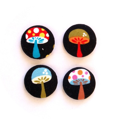 Four toadstool fabric badges